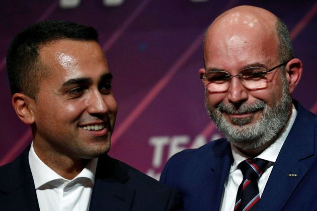 Italy's Foreign Minister Luigi di Maio poses with 5-Star Movement's new caretaker leader Vito Crimi after...
