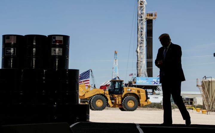 President Donald Trump arrives to deliver a speech during a tour of an oil rig in Midland, Texas, in July. a