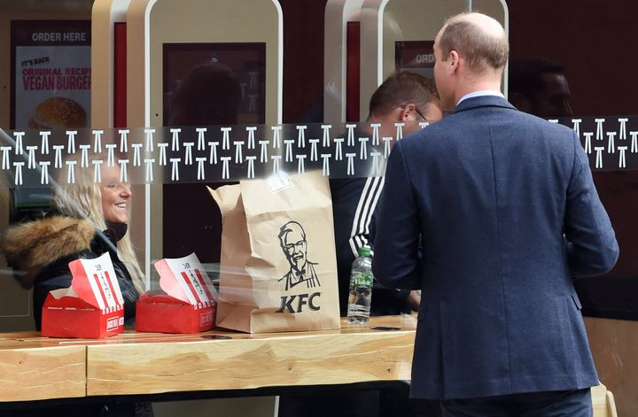 Wiliam speaks to a member of the public through the window of a KFC restaurant at Waterloo Station on Oct. 20 in London.