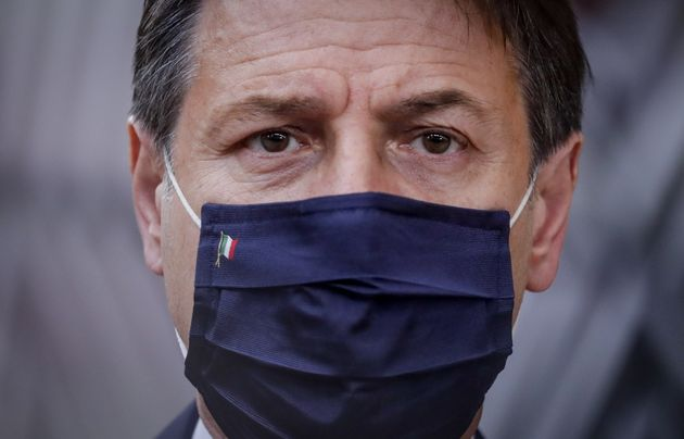 Italian Prime Minister Giuseppe Conte wearing a face mask arrives ahead of a two days European Union...
