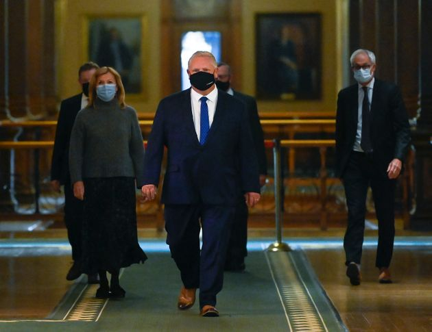 Ontario Premier Doug Ford walks to a press conference at Queen's Park on Oct. 2,