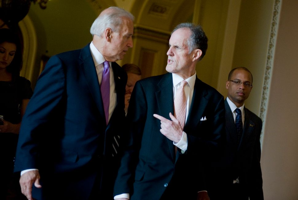 Kaufman, then a senator, and then-Vice President Biden are seen here conversing in the halls of Congress. The two men never d