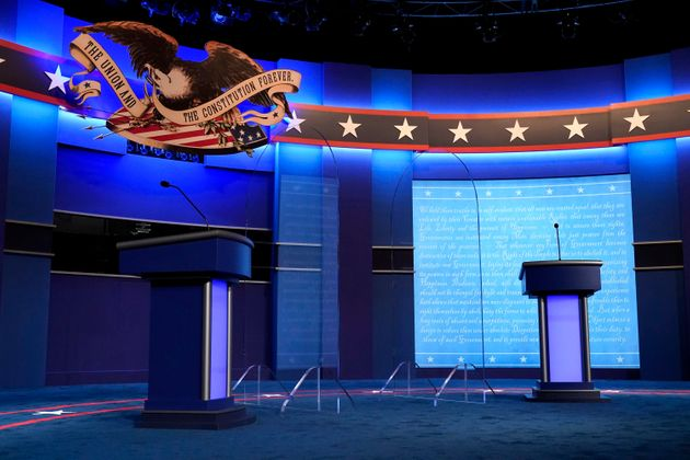 Clear protective panels stand onstage between lecterns for President Donald Trump and Democratic presidential...