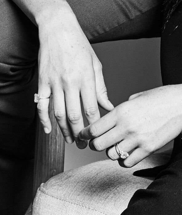 A close-up of Meghan Markle's hands, showing her pinky ring and her engagement ring.