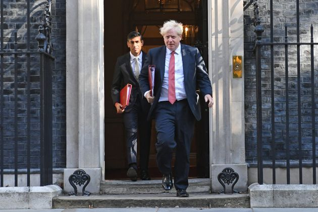 Chancellor of the Exchequer Rishi Sunak (left) and Prime Minister Boris Johnson leave 10 Downing
