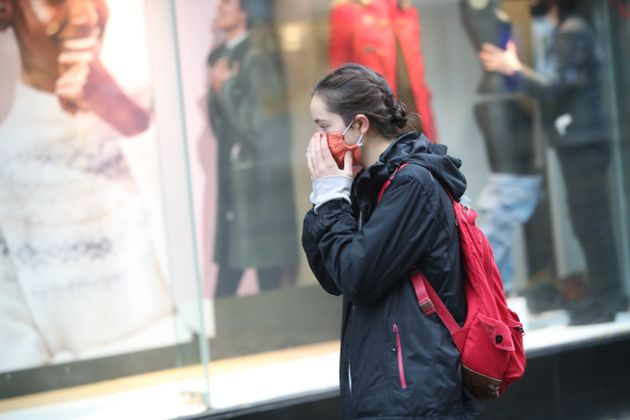 A woman wearing a face mask in Sheffield city centre, as South Yorkshire becomes the latest region to...