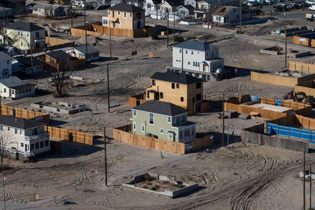 Homes sit under construction one year after being destroyed by Superstorm Sandy in the Breezy Point neighborhood...