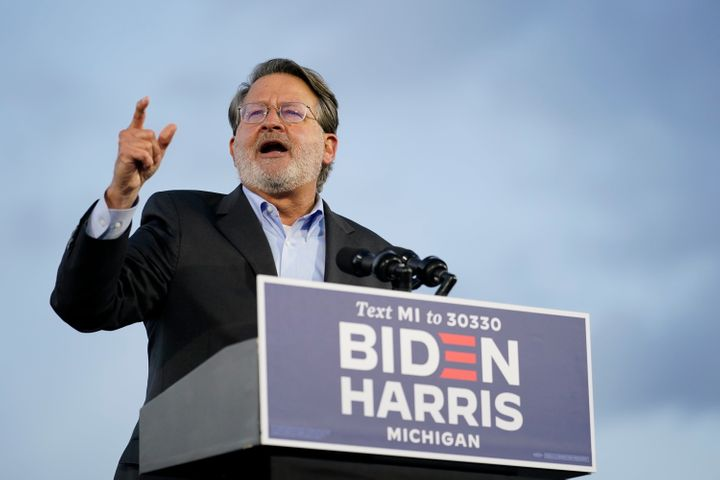 Sen. Gary Peters speaks during an event for Democratic presidential nominee Joe Biden at the Michigan State Fairgrounds in No