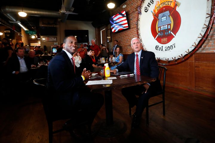 Vice President Mike Pence and Republican U.S. Senate candidate John James sit for lunch at The Engine House in Mount Clemens,