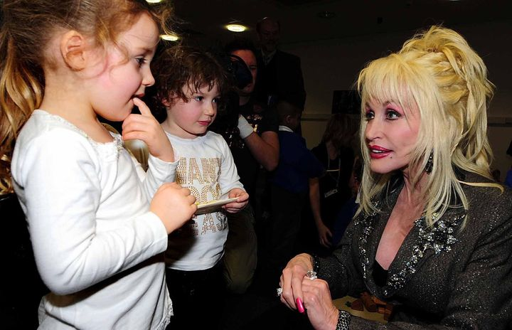 Dolly Parton meeting with kids as she launches the Imagination Library in Rotherham, South Yorkshire, U.K., in 2007.