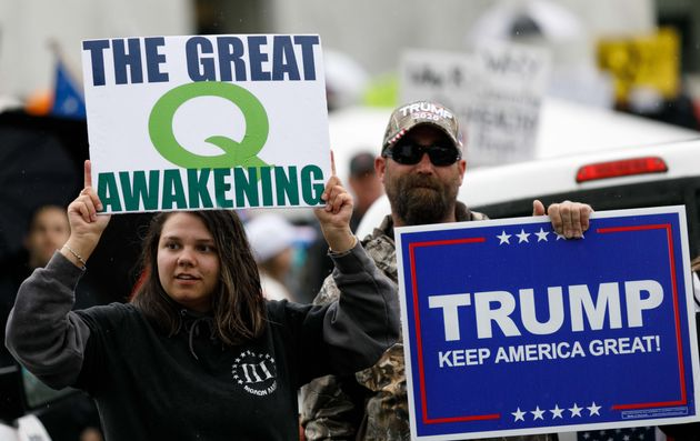 QAnon conspiracy theorists hold signs during a protest at the state Capitol in Salem, Oregon, May 2, 2020.