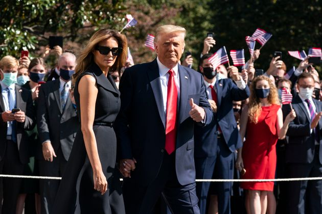 Donald Trump and first lady Melania Trump walk to board Marine One on the South Lawn of the White House,...