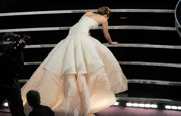 Jennifer Lawrence stumbling as she walks to the stage to during the 2012 Oscars.