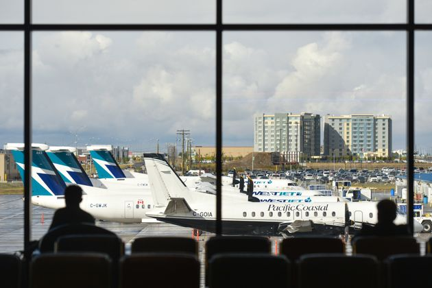 A view of WestJet planes at Calgary International Airport on Sept. 10,