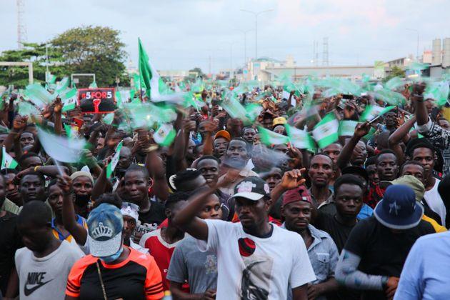 LAGOS, NIGERIA - OCTOBER 20: Demonstrators protest police brutality at the Lekki toll gate on October...