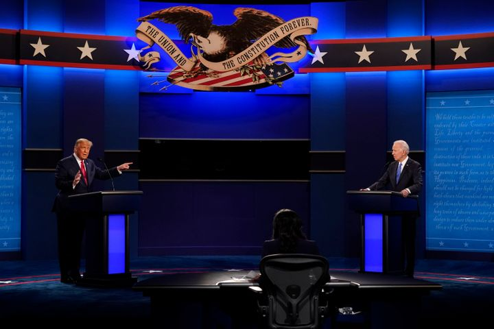 President Donald Trump points toward Democratic presidential candidate Joe Biden during the second and final presidential debate Thursday at Belmont University in Nashville.