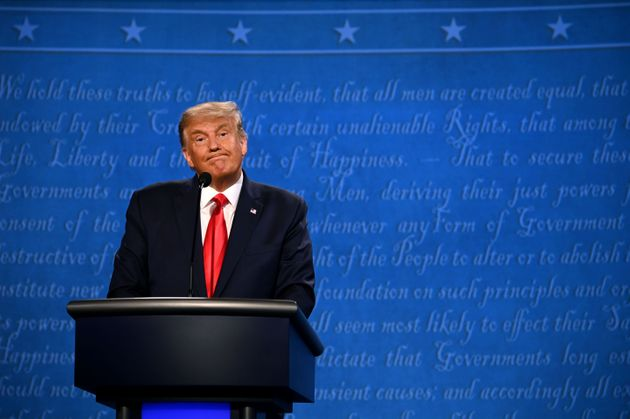 President Donald Trump reacts during the final presidential debate at Belmont University in Nashville,