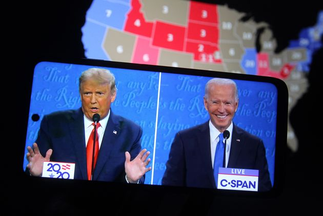 UKRAINE - 2020/10/23: In this photo illustration the US President Donald Trump and Democratic presidential candidate and former US Vice President Joe Biden are seen during the final presidential debate displayed on a screen of a smartphone. The final presidential debate between President Donald Trump and former Vice President Joe Biden took place at Belmont University in Nashville, the U.S. on Thursday, October 22. United States presidential election scheduled for November 3, 2020. (Photo Illustration by Pavlo Conchar/SOPA Images/LightRocket via Getty Images)