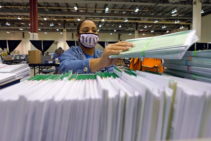 Harris County election worker Romanique Tillman prepares mail-in ballots to be sent out to voters Tuesday, Sept. 29, 2020, in