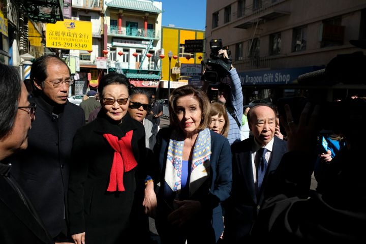 House Speaker Nancy Pelosi (D-Calif.), walks with Florence Fang, second from left, to a temple during a tour of Chinatown on