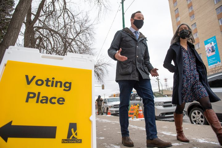 Saskatchewan New Democratic Party leader Ryan Meili, left, departing a polling station after voting in the advanced poll in Saskatoon, Tuesday, Oct. 20, 2020.