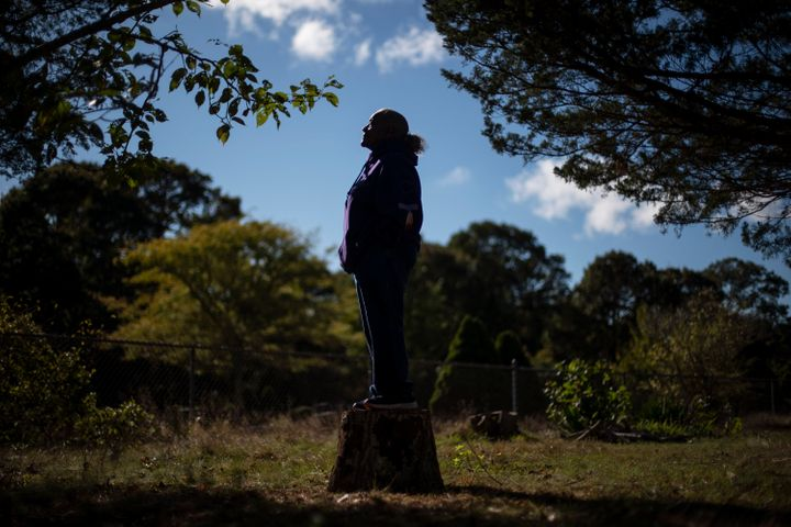 Hazel Harding Currence, 78, a Herring Pond Wampanoag Tribe Elder, stands for a photo in her backyard in Bourne, Mass., Tuesda