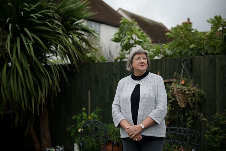 Mayflower descendant Vicky Cosstick poses for a portrait in the back garden of her home in the town of Seaford, on the south