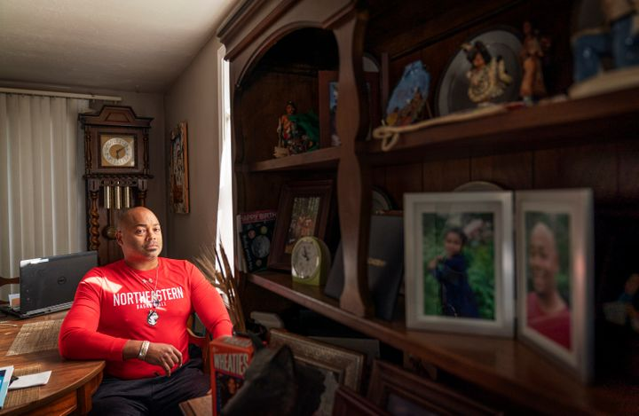 Troy Currence, 48, a medicine man from the Herring Pond Wampanaoag Tribe, sits for a photo at his home in Bourne, Mass., Mond