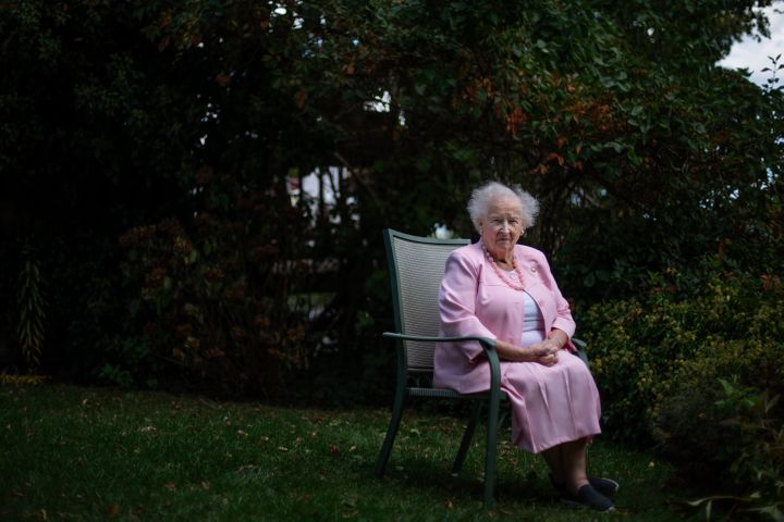 Ginny Mucciaccio, 90, a direct descendant of a Pilgrim who came over on the Mayflower, sits for a portrait in Plymouth, Mass.
