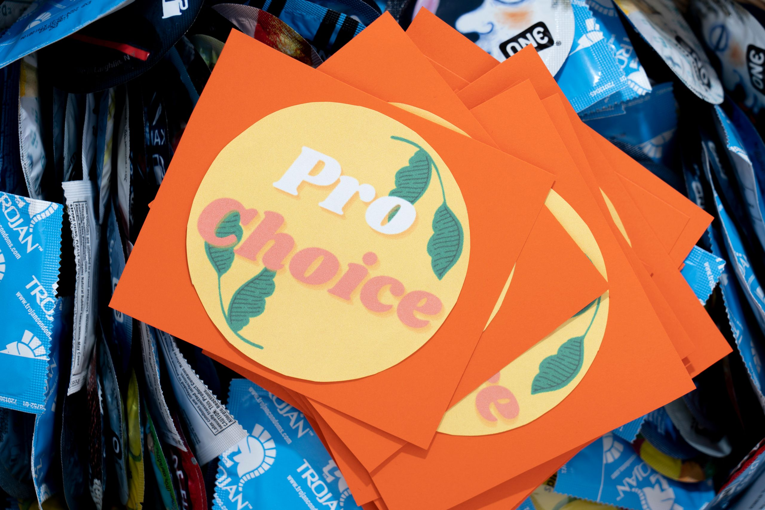 A pro-choice bumper sticker sits on a basket of condoms on campus at Saint Mary's College.