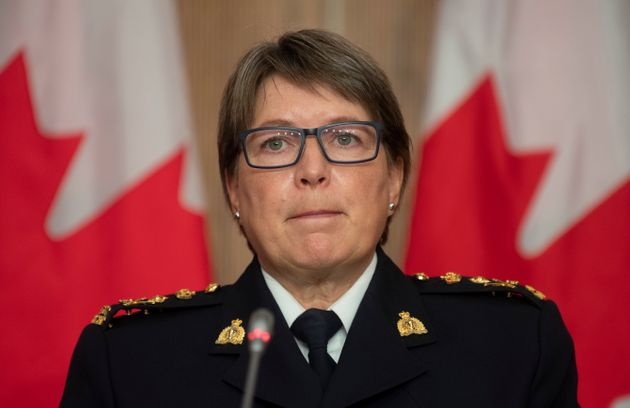 RCMP Commissioner Brenda Lucki listens to a question during a news conference in Ottawa on