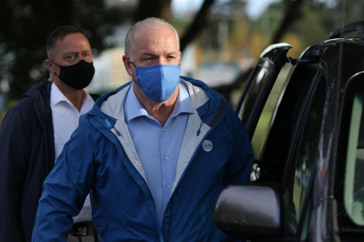 B.C. NDP Leader John Horgan leaves after voting in advance polls for the provincial election in Langford, B.C. on Oct. 19, 2020.