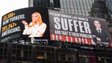 NEW YORK, NEW YORK - OCTOBER 22: New billboard by The Lincoln Project depicts Ivanka Trump presenting the number of New Yorkers and Americans who have died due to COVID-19 and Jared Kushner with a Vanity Fair quote in Times Square as the city continues the re-opening efforts following restrictions imposed to slow the spread of coronavirus on October 22, 2020 in New York City. The pandemic has caused long-term repercussions throughout the tourism and entertainment industries, including short-term and permanent closures of historic and iconic venues, and costing the city and businesses billions in revenue.  (Photo by Noam Galai/Getty Images)