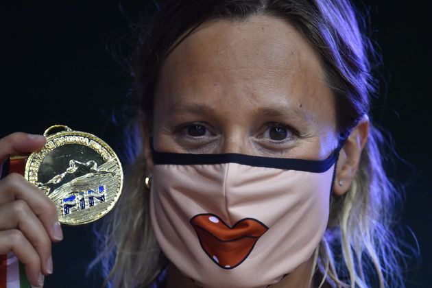 FORO ITALICO, ROME, ITALY - 2020/08/13: Federica Pellegrini of Italy shows the gold medal wearing a mask...