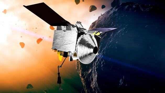 Une illustration fournie par la NASA montrent la sonde Osiris-Rex autour de l'astéroïde Bennu...