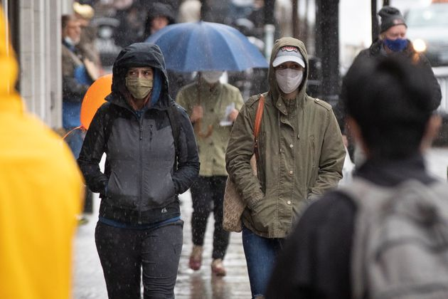Several people wear masks in Kingston, Ont. on Oct. 19,