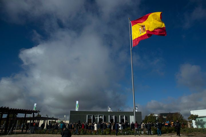 The Spanish flag flies during a memorial for coronavirus victims in Madrid, Spain, on Friday. Spanish Prime Minister Pedro Sa