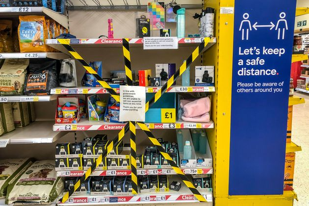 Shelves in a supermarket near Cardiff are deemed non-essential items and are taped off as