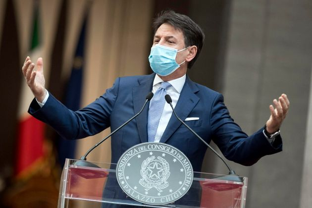 epa08772819 Italian Prime Minister Giuseppe Conte speaks during a press conference to announce a new...