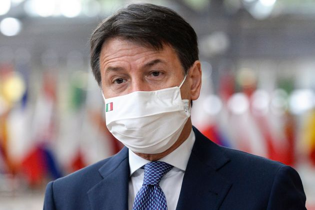 Italy's Prime Minister Giuseppe Conte speaks with the media as he arrives for an EU summit in Brussels,...