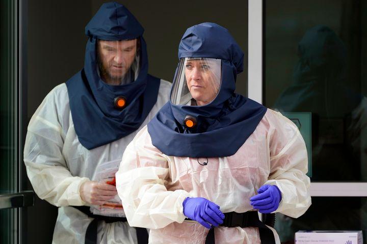 Salt Lake County Health Department public health nurses prepare to conduct coronavirus testing outside the Salt Lake County H