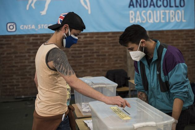 SANTIAGO, CHILE - OCTOBER 25: Citizens of Chile vote during the national referendum, on October 25, 2020...