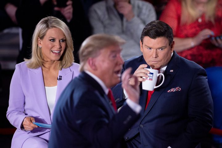 Fox News anchors Martha MacCallum and Bret Baier, pictured in March with Donald Trump, have been asked to quarantine, accordi