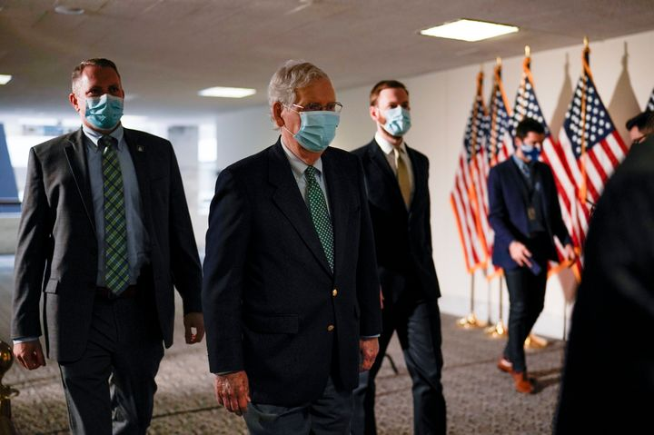 Senate Majority Leader Mitch McConnell, R-Ky., arrives as Republicans work during a rare weekend session to advance the confi