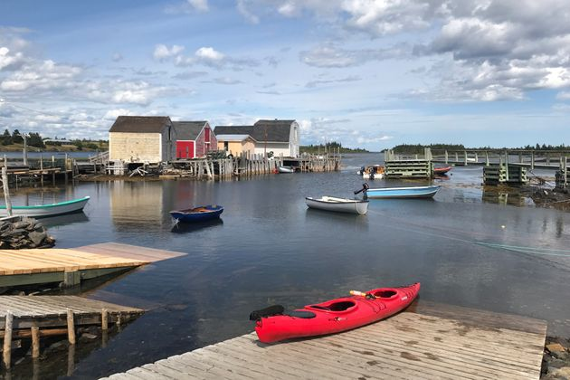 A red kayak is pictured on a dock in Blue Rocks, N.S., in August 2019. East Coast provinces have been...