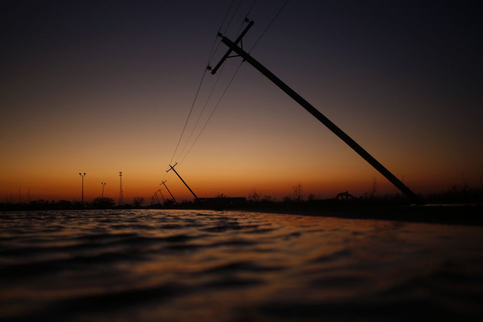 Utility poles felled after Hurricane Delta made landfall in Creole, Louisiana, on Oct. 10, 2020.