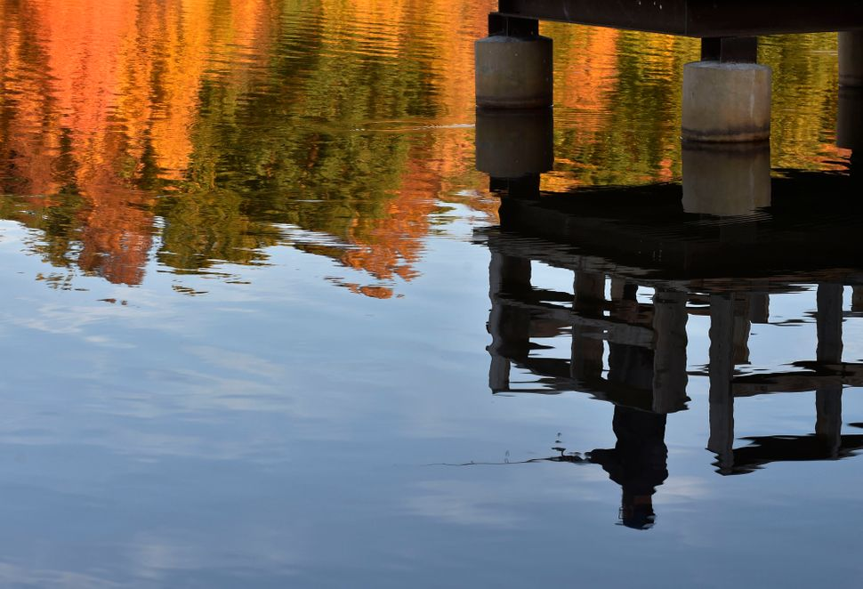 A fisherman reflected in Lake Frances at Frances Slocum State Park, Pennsylvania, on Oct. 14, 2020.