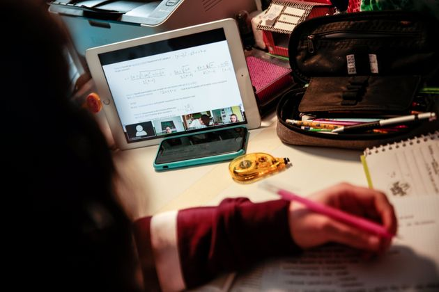 Rome, young person studies at home with other students through the Tablet connected in video chat with...