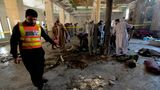 Rescue workers collect remains at the site of a blast in a religious school in Peshawar on October 27, 2020. - At least four students were killed and dozens more wounded on October 27 when a bomb exploded during a class at their religious school in Pakistan, officials said. (Photo by Abdul MAJEED / AFP) (Photo by ABDUL MAJEED/AFP via Getty Images)