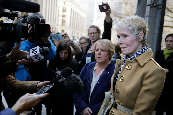 E. Jean Carroll, right, talks to reporters outside a courthouse in New York, Wednesday, March 4, 2020. (AP Photo/Seth Wenig)